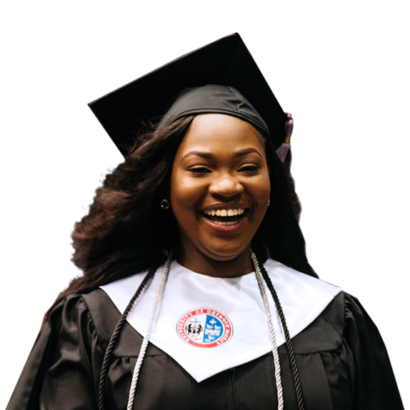 Young woman wearing cap and gown for graduation.