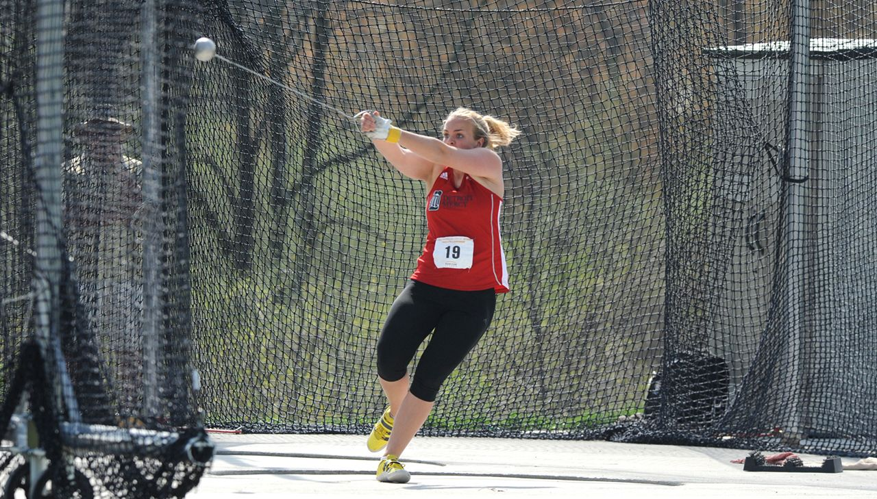 Brynne Gustafson competing for the Titans in the hammer throw event.