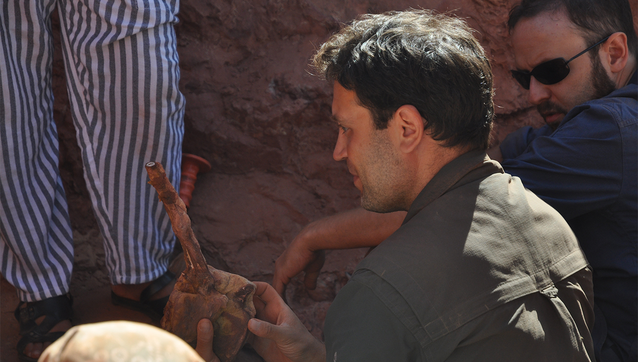 University of Detroit Mercy professor Nizar Ibrahim holds recently discovered fossil.