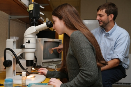 Dr. Jacob Kagey with a student in his lab
