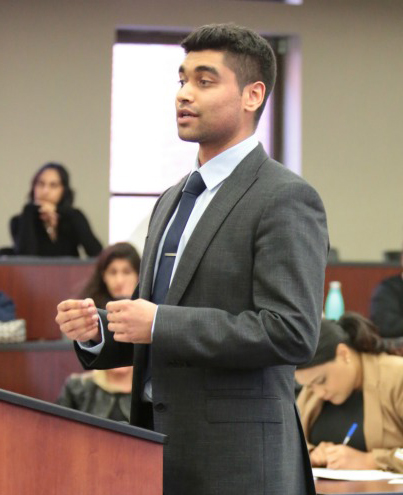 male law student in moot court