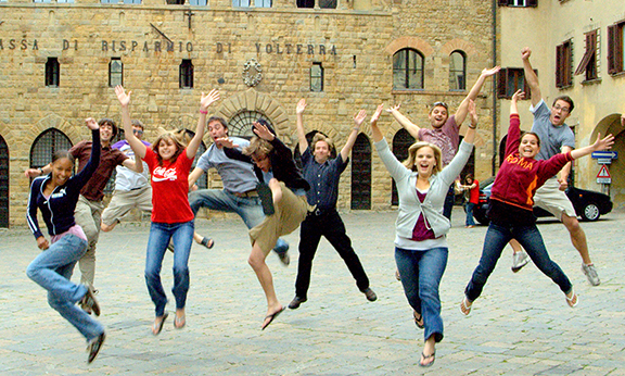 Students in Italy jumping up