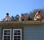 Students repairing roof