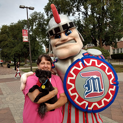 Success Coach Sr. Sarah Foster with her dog Bentley, the SSC therapy dog!